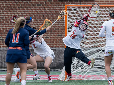 Maryland's Megan Taylor (34) makes an excellent save to hold off the 4th ranked Syracuse University. PHOTO BY MIKE CLARK