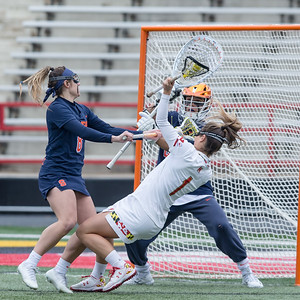 Alexa Radziewicz (8) of Syracuse closes down the path to the goal and Maryland's Brindi Griffin (1) pays the price. PHOTO BY MIKE CLARK