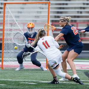 Maryland's Caroline Steele (11) records her second goal on the day against 4th ranked Syracuse. PHOTO BY MIKE CLARK