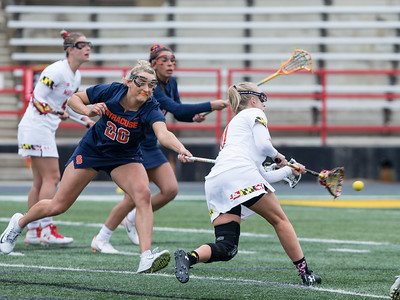 Caroline Steele (11) of Maryland winds up an fires an under-hand shot past Syracuse Goalie Asa Goldstock. PHOTO BY MIKE CLARK