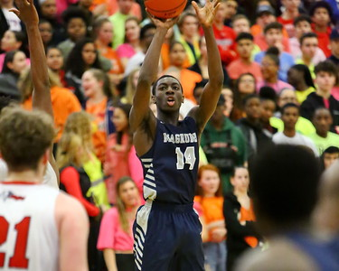 George P. Smith/The Montgomery Sentinel    Magruder's Ebby Asamoah (14) hitting from beyond the arc.