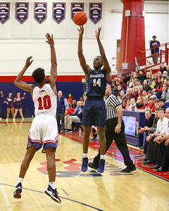 George P. Smith/The Montgomery Sentinel    Magruder's Ebby Asamoah (14) shoots a three over Thomas Johnson's Emmnuel Powe (10) to spark a Colonels comeback attempt.