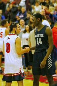 George P. Smith/The Montgomery Sentinel    Respect and good sportsmanship - Thomas Johnson's Richard Rivas (0) and Magruder's Ebby Asamoah (14) shake hands after the  Regional Final.