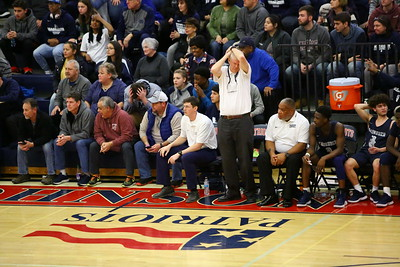 George P. Smith/The Montgomery Sentinel    Magruder head coach Dan Harwood and at least one fan can't bear to watch error after error derail the Colonels' run in the playoffs.