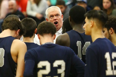 George P. Smith/The Montgomery Sentinel    Magruder head coach Dan Harwood looks at the scoreboard during a timeout in the final seconds of the game.