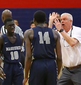 George P. Smith/The Montgomery Sentinel    Magruder's Ebby Asamoah (14) put the team on his back for most of the Regional final but head coach Dan Harwood is rightly incredulous that he didn't take a shot when he should have in the final seconds.