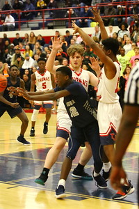 George P. Smith/The Montgomery Sentinel    Magruder's Malik Abudu (32) kicks out to get himself out of a jam against Thomas Johnson High School.