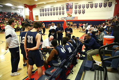 George P. Smith/The Montgomery Sentinel    Magruder head coach Dan Harwood rips into his team during a time out in the 3rd period with his team trailing 43-32.