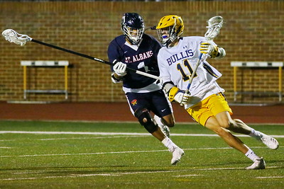 George P. Smith/The Montgomery Sentinel    Bullis' sophmore Connor David (11) turns the corner before scoring one of his three goals against St. Alban's in the game played in Potomac on April 26, 2019.