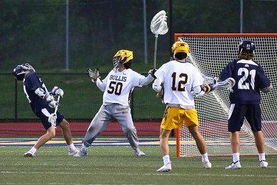 George P. Smith/The Montgomery Sentinel    St. Alban's Jason Lach (14) gets too close to the crease and gets a faceful of crosse as Bullis' goalie Jack Fracyon (50) attempts to clear the ball.