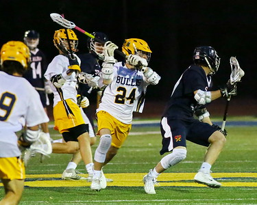 George P. Smith/The Montgomery Sentinel    Bullis' Brian Wilmans (24) looking for the stick check opportunity on St. Alban's Henry Holliday (10).