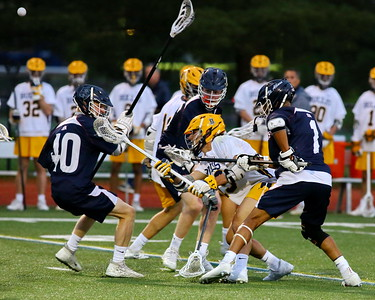 George P. Smith/The Montgomery Sentinel    Bullis' Robert Schain (19) tries an underhand pass (ball upper left) as he gets triple teamed by St. Albans' players.
