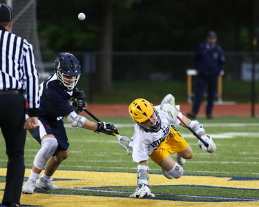 George P. Smith/The Montgomery Sentinel    Bullis' Brian Wilmans (24) beats St. Alban's Matthew Gunty (30) at the face off.
