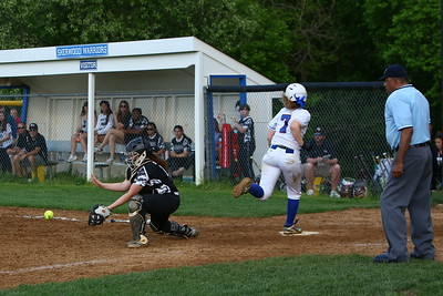 George P. Smith/The Montgomery Sentinel    Sherwood's Kayley Bina (7) scored off of Hannah Bowers'  triiple as the ball was late getting to home plate.