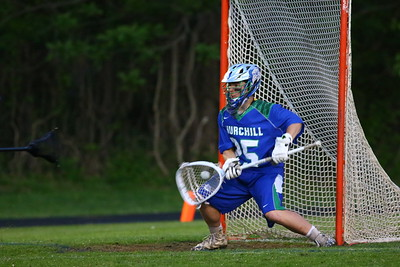 George P. Smith/The Montgomery Sentinel    Churchill's goalie Andrew Robinson (25) stops a shot by Sherwood.