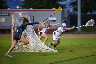 George P. Smith/The Montgomery Sentinel    Good Counsel's Madaleine Rudolph (25), Ireton goalie Ashley Bowan (3), and Ireton's Tess Moore (20) sprint for possession of a loose ball.