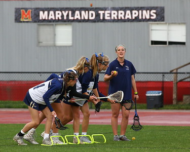 George P. Smith/The Montgomery Sentinel    The Good Counsel girls warm up before the WCAC Final played at the UMCP Ludwig Field against the Bishop Ireton Cardinals on May 13, 2019.
