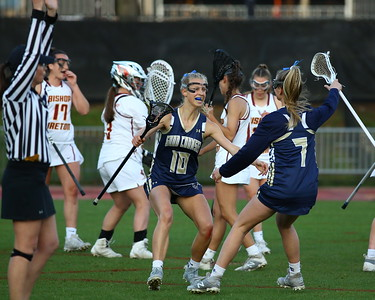 George P. Smith/The Montgomery Sentinel    Good Counsel's Gracie Smith (10) celebrates with her teammate Madison Flynn (7) after Smith scored against Bishop Ireton.