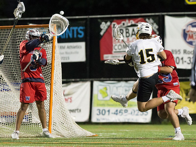 Wootton Goalie Seamus Graham stops the flying shot by Richard Montgomery's Kaden Hoffman. PHOTO BY MIKE CLARK