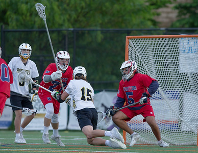 Kaden Hoffman of Richard Montgomery manages to get a shot off but Wootton Goalie Seamus Graham is ready and makes the save. PHOTO BY MIKE CLARK