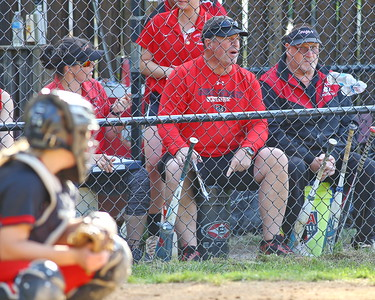 George P. Smith/The Montgomery Sentinel    Quince Orchard assistant coach relays pitch selection to his catcher  Caeleigh Sewell (19).