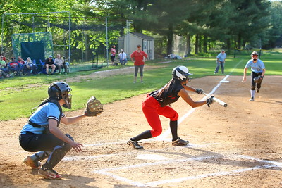 George P. Smith/The Montgomery Sentinel    Quince Orchard's Rachel Datu (8) looks to bunt as the infield rushes in.
