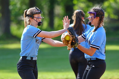 George P. Smith/The Montgomery Sentinel    Whitman pitcher Riley Kuehn (1) high fives Susannah Gordon (6) after an out.