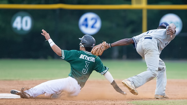 June 6, 2019: Kobe Kato of Bethesda slides safely into second base.  The Big Train base running helped chalk up eight runs in their home opener. Photo by Mike Clark/The Montgomery Sentinel