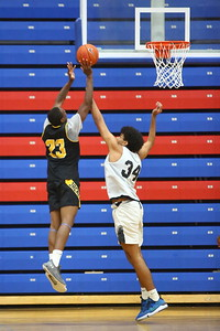 George P. Smith/The Montgomery Sentinel    Gwynn Park's Markeith Franks (23) gets fouled by Richard Montgomery's Will Davenport (34).
