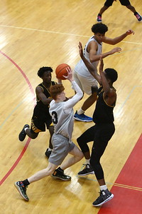 George P. Smith/The Montgomery Sentinel    Richard Montgomery's high scorer, Ryan Cornish, with 28, slices through the Gwynn Park defense for two of his points.