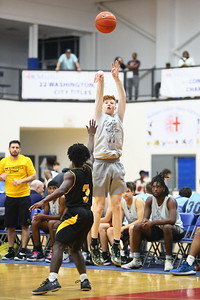 George P. Smith/The Montgomery Sentinel    Richard Montgomery's Ryan Cornish (3) hiting one of his three 3's over Gwyn Park's Christian Hayes (3). Cornish was 3-8 beyond the arc and 9-17 inside the arc for 28 game points - the high scorer  for RM and the game.