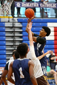 George P. Smith/The Montgomery Sentinel    Georgetown Prep's Stefan Marcelle (25) taking it to the hoop through traffic.