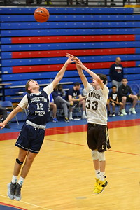 George P. Smith/The Montgomery Sentinel    Landon's Sammy Hemann (33) shooting a three over Georgetown Prep's Mark LLewellyn (12) from well beyond the arc.