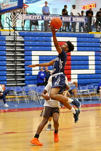 George P. Smith/The Montgomery Sentinel    Georgetown Prep's AJ Thomas (2) with the layup off the transition.