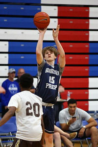 George P. Smith/The Montgomery Sentinel    Georgetown Prep's Ben Woodward (15) shooting over Landon's Kino Lilly (20) from beyond the arc.