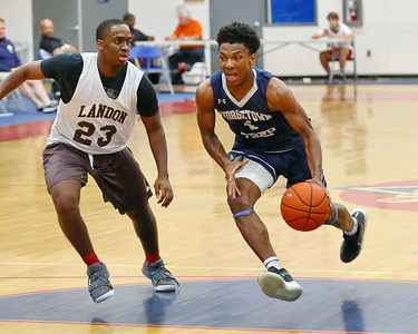 George P. Smith/The Montgomery Sentinel    Georgetown Prep's Zion Russel (1) driving the lane past Landon's Mike Gray (23).