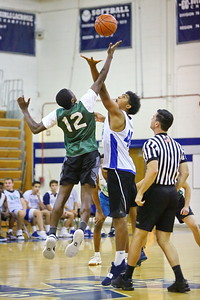 George P. Smith/The Montgomery Sentinel    Damascus' Jalen Grimes (12) and Churchill's Joseph Marley (45) at the tip off.