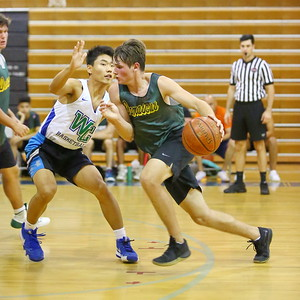 George P. Smith/The Montgomery Sentinel    Damascus' Brinton Gottfredson (10) driving the lane against Churchill's Andy Chiang (34).