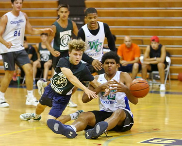 George P. Smith/The Montgomery Sentinel    Damascus' Kevin Brown (2) and Churchill's Joseph Marley (45) battle for a loose ball.