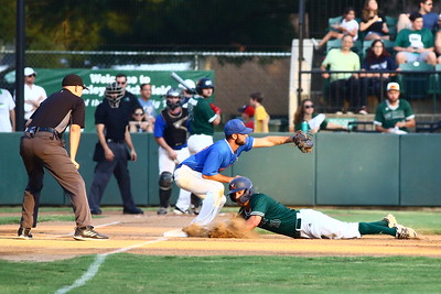 George P. Smith/The Montgomery Sentinel    Bethesda Big Train's Drew Hamrock (20) dives for the bag as  Anthony Gallo (29) as he got back to the base and caused the ball to pop out of Gallo's glove.