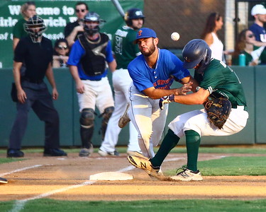 George P. Smith/The Montgomery Sentinel    Bethesda Big Train's Drew Hamrock (20) should have been out at 1st but he collided with first baseman Anthony Gallo (29) as he got back to the base and caused the ball to pop out of Gallo's glove.