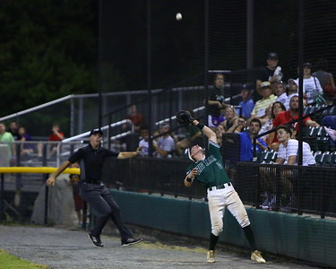 George P. Smith/The Montgomery Sentinel    Bethesda Big Train's  Matt Thomas outfielder gets under a pop up by the 1st base stands as the ref is right there to make the call.