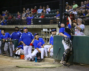 George P. Smith/The Montgomery Sentinel    Silver Spring-Takoma Thunderbolts' catcher Tyler Murray (17) makes a nice catch next to the backstop as teammates in the dugout watch.