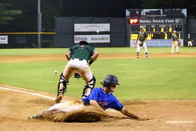 George P. Smith/The Montgomery Sentinel    Silver Spring-Takoma Thunderbolts' Ian McMillan (9) beats the ball to home plate.