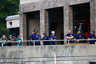 George P. Smith/The Montgomery Sentinel    Staff from the Bethesda Big Train join firefighters on duty at Montgomery County Division of Fire and SRescue Services (DFRS) Station 16, which overlooks the baseball field at Montgomery Blair High School, in watching the 2nd game of the Cal Ripken Collegiate Baseball League (CRCBL) League Championship Series between the Bethesda Big Train and the Silver Spring-Takoma Thunderbolts.