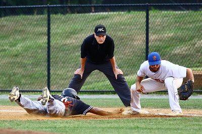 George P. Smith/The Montgomery Sentinel    Bethesda Big Train's Darius Foster (6) beat the pick off throw from Zeke Gongola (39) to 1st baseman Anthony Gallo (29).