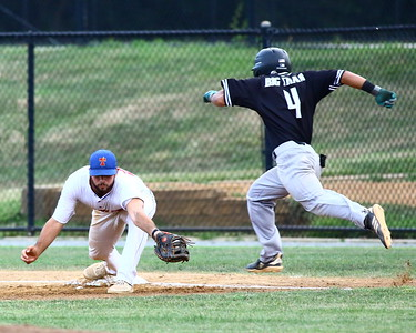 George P. Smith/The Montgomery Sentinel    The throw from Silver Spring-Takoma Thunderbolts' Ian McMillan (9) to 1st baseman Anthony Gallo (29) was on time to get Bethesda Big Train's Keith Torres III (4).