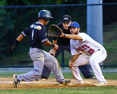George P. Smith/The Montgomery Sentinel    Bethesda Big Train's  Keith Torres III (4) beats the throw to 1st baseman Anthony Gallo (29).