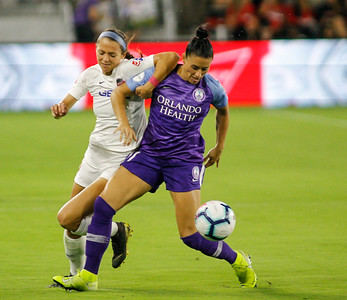 August 24, 2019: Spirit Ashley Hatch (33) and Pride Ali Krieger (11) battles for an loose ball during NWSL action between Orlando Pride and Washington Spirit in Washington DC. Photos by Chris Thompkins/Montgomery County Sentinel