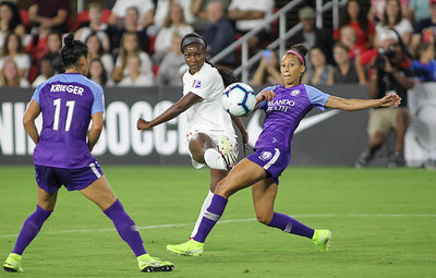August 24, 2019: Spirit Cheyna Matthews (20) attempts an shot past Pride defenders during NWSL action between Orlando Pride and Washington Spirit in Washington DC. Photos by Chris Thompkins/Montgomery County Sentinel